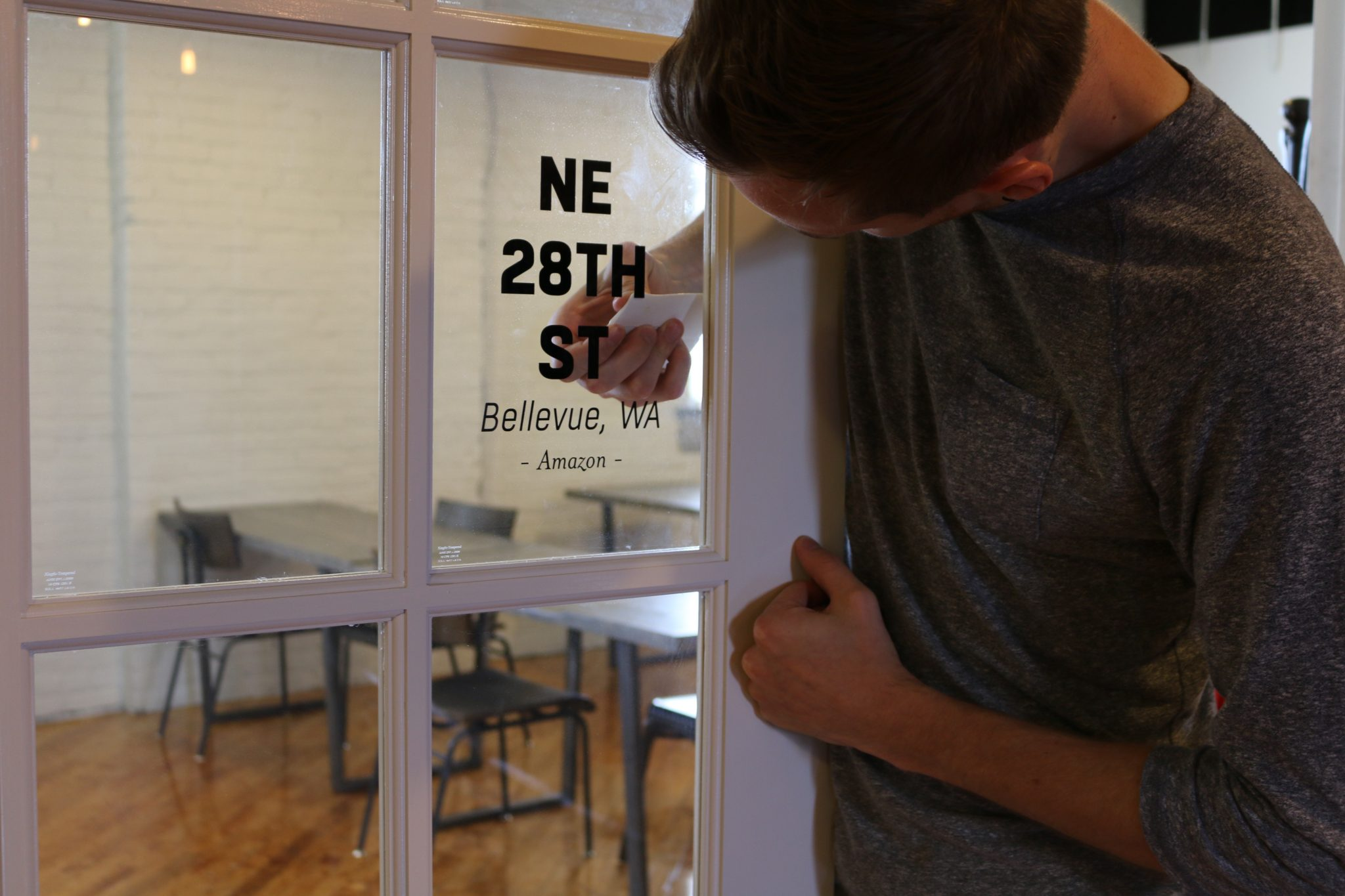 Nick putting the finishing touches on our conference room name stamp. (All of our rooms are named after the garages of entrepreneurs we admire.)